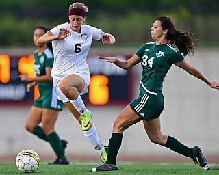 YOUNGSTOWN, OHIO - SEPTEMBER 5, 2018: Boardman's Anna Deeley jumps over Ursuline's Lucia Rohrbaugh while dribbling upfield during the second half of their game on Wednesday night at the Youngstown State soccer complex. DAVID DERMER | THE VINDICATOR
