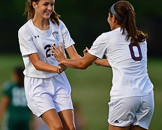 YOUNGSTOWN, OHIO - SEPTEMBER 5, 2018: Boardman's Serene Khatib, right, is congratulated by teammate Ashley Harding after scoring a goal during the second half of their game on Wednesday night at the Youngstown State soccer complex. DAVID DERMER | THE VINDICATOR