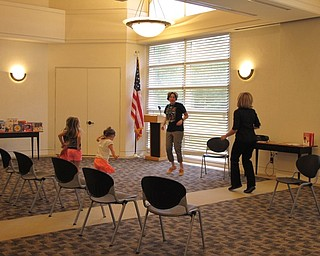 Neighbors | Jessica Harker.Librarians Nikki Puhalla and Lindsay Cramer danced with incoming Kindergarteners at the Aug. 8 Get Ready for Kindergarten event at the Austintown library.