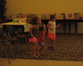 Neighbors | Jessica Harker.Children in attendence at the Getting Ready for Kindergarten event danced to a song being played by librarians to help them gain listening and instruction following skills before entering school.