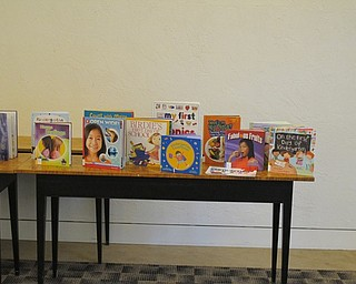 Neighbors | Jessica Harker.Books about different skills for Kindergarteners were set up in the Austintown library during the Getting Ready for Kindergarten event.