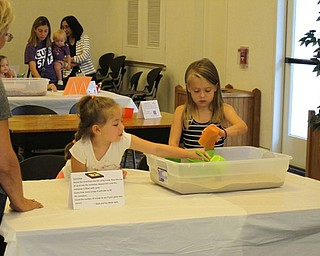 Neighbors | Jessica Harker.Leah Ordean and Eden Gabrick worked together at one of the stations during the Getting Ready for Kindergarten event on Aug. 8 at the Austintown library.