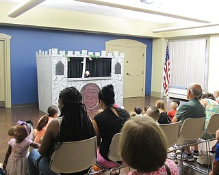 Neighbors | Jessica Harker .Those in attendance watched as the story of Humpty Dumpty played out on stage during the Puppets! Puppets! Puppets! event on Aug. 8.