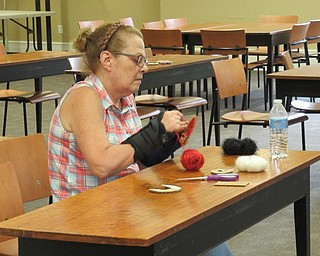 Neighbors | Jessica Harker.Sue Moderalli makes a pompom during the crafting project at the Poland library August 20.