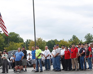 Veterans in the crowd stand while the Austintown Fitch High School concert choir sings at the Austintown Patriot Day ceremony outside of Quaker Steak and Lube in Austintown on Thursday. EMILY MATTHEWS | THE VINDICATOR