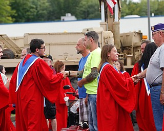 The Austintown Fitch High School concert choir shakes hands with veterans in the crowd at the Austintown Patriot Day ceremony outside of Quaker Steak and Lube in Austintown on Thursday. EMILY MATTHEWS | THE VINDICATOR