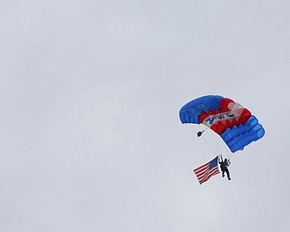 Jimmy Drummond, of Youngstown, skydives at the Austintown Patriot Day ceremony outside of Quaker Steak and Lube in Austintown on Thursday. EMILY MATTHEWS | THE VINDICATOR