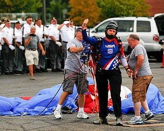 Jimmy Drummond, of Youngstown, lands after skydiving at the Austintown Patriot Day ceremony outside of Quaker Steak and Lube in Austintown on Thursday. EMILY MATTHEWS | THE VINDICATOR