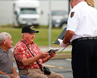 Roy Gallatin, a U.S.M.C veteran of World War ||, is honored with 12 other veterans at the Austintown Patriot Day ceremony outside of Quaker Steak and Lube in Austintown on Thursday. EMILY MATTHEWS | THE VINDICATOR