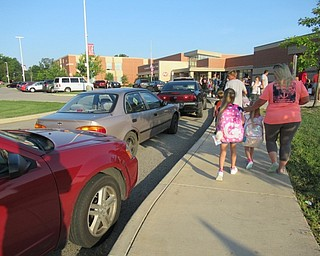 Neighbors | Jessica Harker.Dozens of cars lined the side walk up to Austintown Elementary School for the first day of classes.