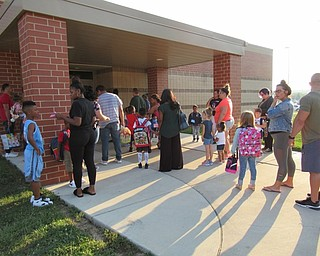Neighbors | Jessica Harker.Children and their guardians waited outside of Austintown Elementary School on Aug. 28 to enter and start the first day of the new year.