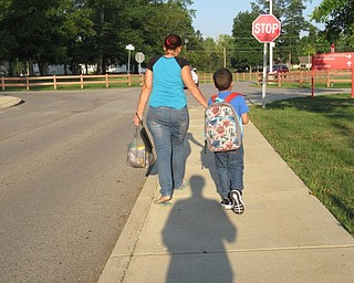Neighbors | Jessica Harker.Children walk into Austintown Elementary School on Aug. 28 for the first day of classes for the Austintown school district.