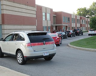 Neighbors | Jessica Harker.Cars lined the side walk up to Austintown Elementary School as students were dropped off for their first day of classes.