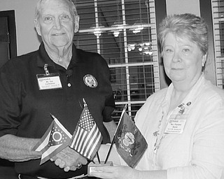 Neighbors | Submitted.Jim Cardamon is pictured receiving a flag set from MSVC-MOAA President Florence Hosler. Cardamon is an Army Veteran and former Sentinel at the Tomb of the Unknowns at Arlington National Cemetery.
