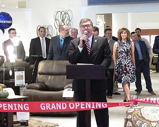 Neighbors | Jessica Harker.Levin Furniture employee John Cline spoke during the grand opening ceremony August 31 at the new location on Boardman-Poland road.