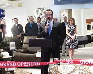 Neighbors | Jessica Harker.Chris Pelcher, the Executive Vice President of Levin Furniture, spoke at the grand opening event of the Levin's Boardman store.