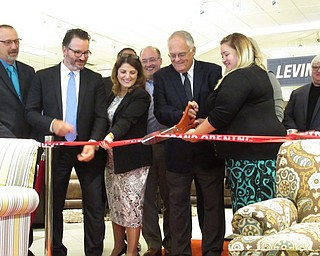 Neighbors | Jessica Harker.Levin Furniture employees cut the ribbion officially opening the new store at 300 Boardman-Poland road August 30.