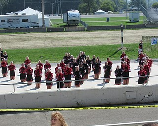 Neighbors | Jessica Harker.Members of the Canfield Cheerleading Squad performed cheers along with stunts during the Cheerleading Demonstrations at the Canfield Fair August 29.