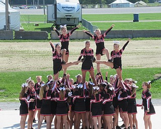 Neighbors | Jessica Harker.Five girls were held up by other members of the Canfield Cheerleading Squad during their performance at the Canfield Fair August 29.