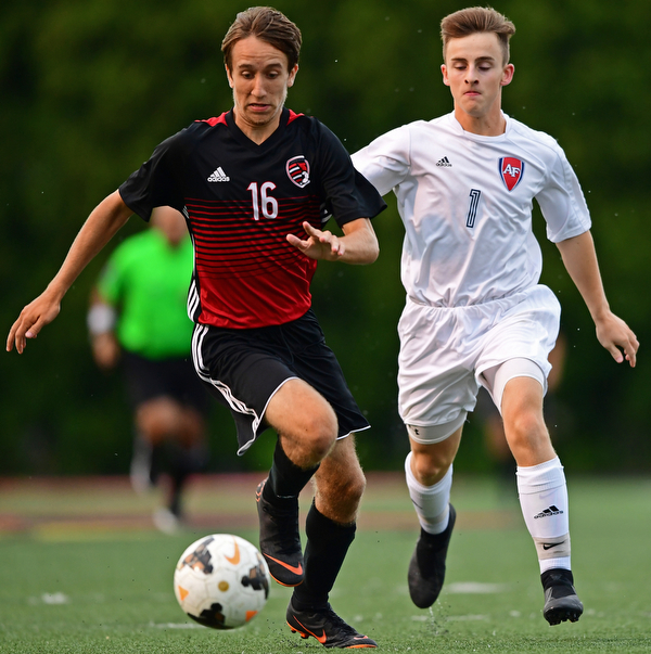 CANFIELD, OHIO - SEPTEMBER 6, 2018: Canfield's Matt Beck plays the ball ahead of Fitch's Andrew Lescsak during the first half of their game, Thursday night at Canfield High School. DAVID DERMER | THE VINDICATOR
