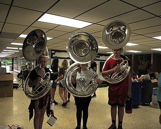 Neighbors | Jessica Harker.Three high school students posed with their new tubas, recently purchased by the Austintown Band Parents Association, on Aug. 1 at Fitch's annual band camp.