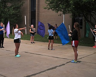 Neighbors | Jessica Harker.Austintown flag line practiced outside of the school on Aug. 1 for Fitch's annual band camp.
