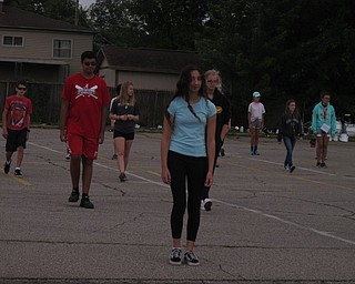 Neighbors | Jessica Harker.Amani Wadi-Ramahi marched in the front of a group of students practicing drills during the 2018 Austintown band camp.