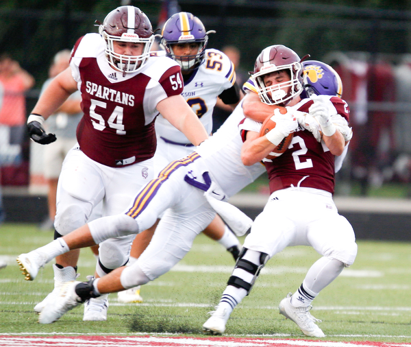 Jackson's Jake Ryan tackles Boardman's Joe Ieraci during the first half of their game Friday night at Boardman. EMILY MATTHEWS | THE VINDICATOR