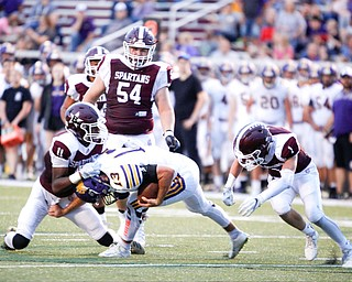 Boardman's Che Trevena (11) and Mike Fesko (1) go after Jackson's Trey Wright during the first half of their game Friday night at Boardman. EMILY MATTHEWS | THE VINDICATOR