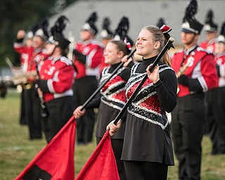 DiaNNA OATRIDGE | THE VINDICATOR Stuthers' flagline and band perform the pre-game cermonies prior to the Niles vs Struthers football game in Stuthers on Friday night.