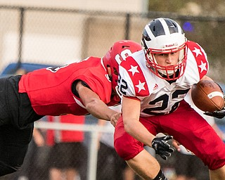 DIANNA OATRIDGE | THE VINDICATOR  Niles' Travis Molnar (22) tries to avoid a tackle by Struthers' Tyrese Hawkins (5) during their game in Struthers on Friday.