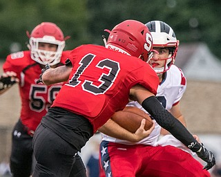 DIANNA OATRIDGE | THE VINDICATOR Struthers' Keith Burnside (13) and Declan Sekol (59)         pursue Niles' Zack Leonard (8) during their game in Struthers on Friday.