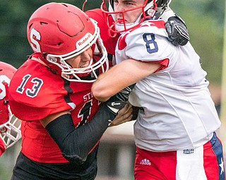 DIANNA OATRIDGE | THE VINDICATOR Struthers' Keith Burnside (13) brings down Niles' Zack Leonard (8) during their game in Struthers on Friday.