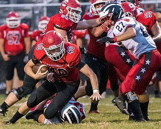 DIANNA OATRIDGE | THE VINDICATOR Struthers' Joseph Macciomei is tackled during their game against Niles on Friday night in Struthers.