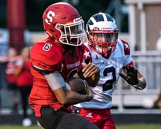 DIANNA OATRIDGE | THE VINDICATOR Struthers' Adrian Brown (6) rushes for a touchdown with Niles' Jayden Davis (2) in pursuit during their game in Struthers on Friday.