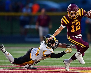 NORGH LIMA, OHIO - SEPTEMBER 7, 2018: South Range's Isaac Allegretto slips free from Crestview's Justin Collins during the first half fo their game, Friday night at South Range High School. DAVID DERMER | THE VINDICATOR