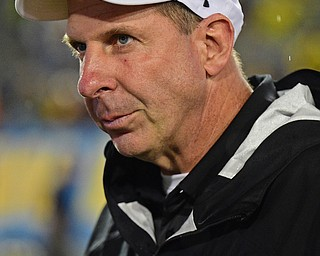 MORGANTOWN, WEST VIRGINIA - SEPTEMBER 8, 2018: Youngstown State head coach Bo Pelini walks off the field after Youngstown State was defeated 52-17 by West Virginia, Saturday night. DAVID DERMER | THE VINDICATOR