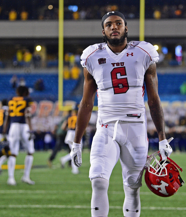 MORGANTOWN, WEST VIRGINIA - SEPTEMBER 8, 2018: Youngstown State's Kendrick Mallory walks off the field after Youngstown State was defeated 52-17 by West Virginia, Saturday night. DAVID DERMER | THE VINDICATOR