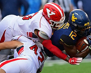 MORGANTOWN, WEST VIRGINIA - SEPTEMBER 8, 2018: West Virginia's Gary Jennings Jr. is tackled by Youngstown State's Armand Dellovade and Cash Mitchell during the first half of their game, Saturday night. DAVID DERMER | THE VINDICATOR