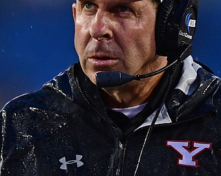 MORGANTOWN, WEST VIRGINIA - SEPTEMBER 8, 2018: Youngstown State head coach Bo Pelini looks at the scoreboard during the first half of their game, Saturday night. DAVID DERMER | THE VINDICATOR