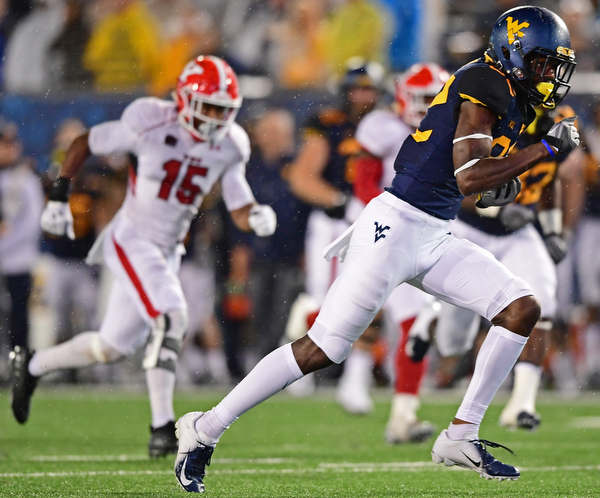 MORGANTOWN, WEST VIRGINIA - SEPTEMBER 8, 2018: West Virginia's Dominique Maiden runs away from he Youngstown State defense and into the end zone to score a touchdown during the second half of their game, Saturday night. West Virginia won 52-17. DAVID DERMER | THE VINDICATOR