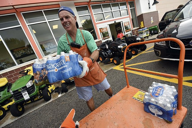 Chris Rayner helps customers load their cars as they buy supplies at The Home Depot. Preparations for Florence were intensifying up and down the densely populated coast. Since reliable record-keeping began more than 150 years ago, North Carolina has been hit by only one Category 4 hurricane: Hazel, with 130 mph winds, in 1954.