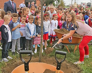 Teacher Tami Socie and Stadium Drive Elementary students joined members of the Boardman fire and police departments on Tuesday at the new fire station for the planting of a purple plum tree on 9/11. The station is also the future site of a memorial for first responders.