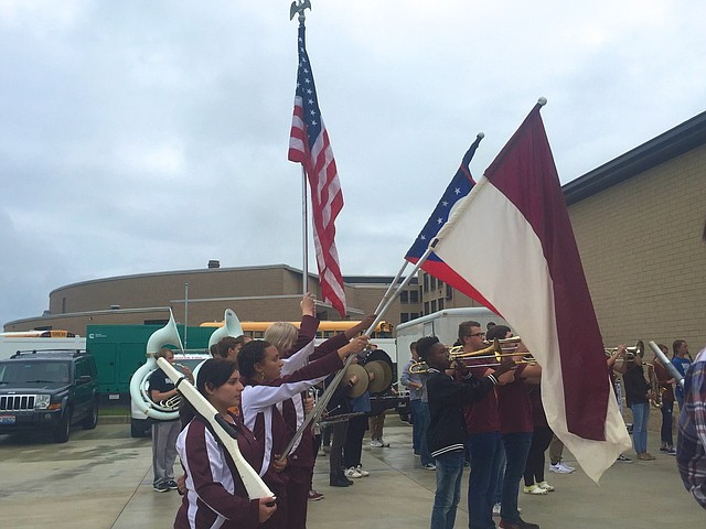 The  band plays as Stadium Drive Elementary School students gathered this morning at the new Boardman fire station to plant a tree in honor of Patriot Day.