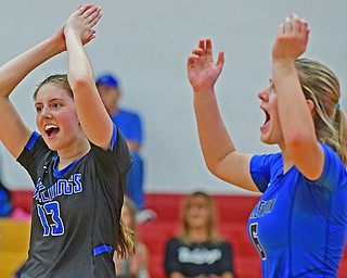 Lakeview's Lexi Inman, left, and Casey Sanford celebrate after a Lakeview point during their match on Monday night at Cardinal Mooney High School.
