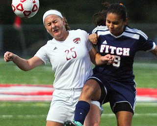 William D. Leiws The Vindicator  Canfield's Hannah Stein(25) and Fitch's Jackie Arroyo (19) during 9-12-18 action at Fitch.