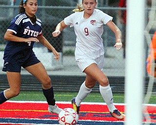 William D. Lewis The Vindicator  Canfield's Morgan Carey(9) and Fitch's Sarah Egolf (4).during 9-12-18 action at Fitch.