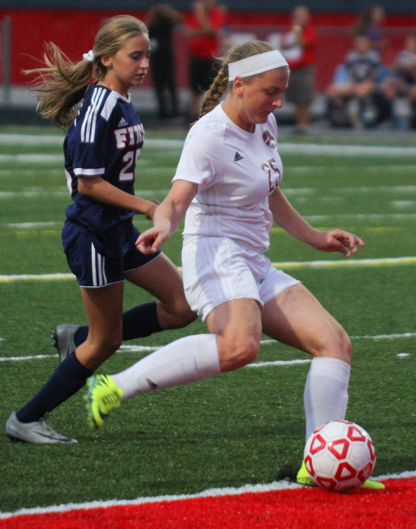 William D. Leiws The Vindicator  Canfield's Hannah Stein(25) scores the 1st goal while Fitch's Kristin Yeager (25) defends during 9-12-18 action at Fitch.