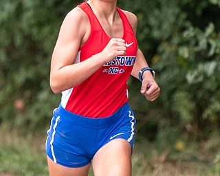 DIANNA OATRIDGE | THE VINDICATOR Lordstown's Jessica Wilk, who finished in second place, runs during the Suburban Cross Country meet at Austintown Park on Tuesday.