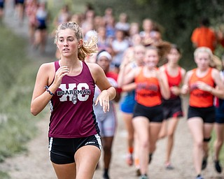 DIANNA OATRIDGE | THE VINDICATOR Boardman's Emily Olexa leads a group of runners during the Suburban Cross Country meet at Austintown Park on Tuesday.